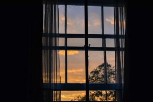 window looking out to a sunset